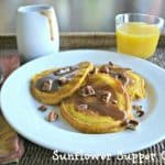 Pumpkin Pancakes with Cinnamon Syrup and Toasted Pecans